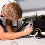 Male Technician Checking Refrigerator
