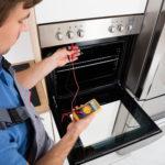 Male Technician Checking Oven