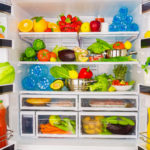 Full open fridge with lots of vegetables
