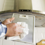 cleaning an extractor hood filter